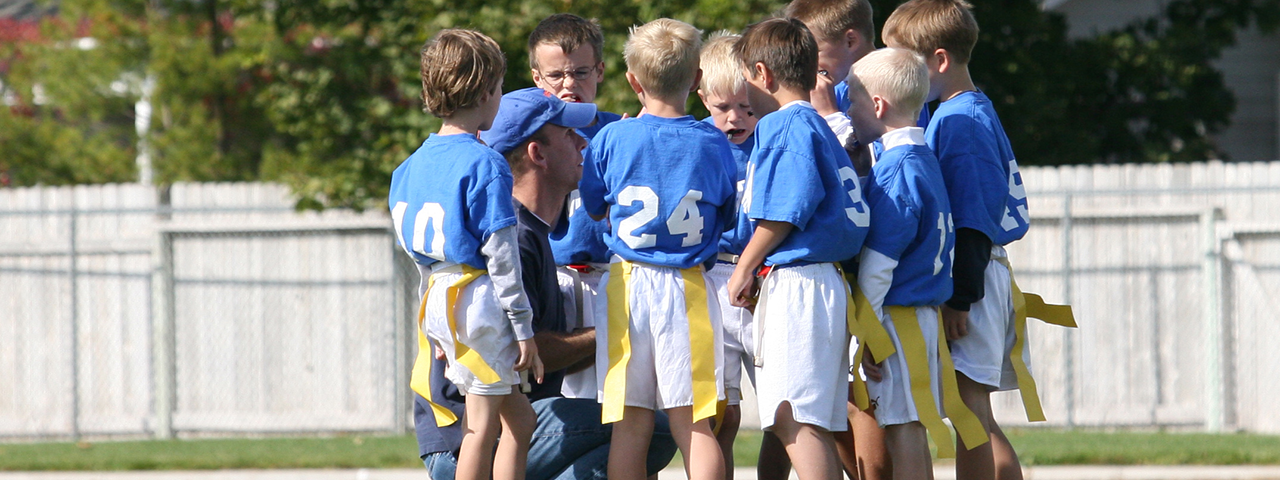 Coaching a group of young flag football players