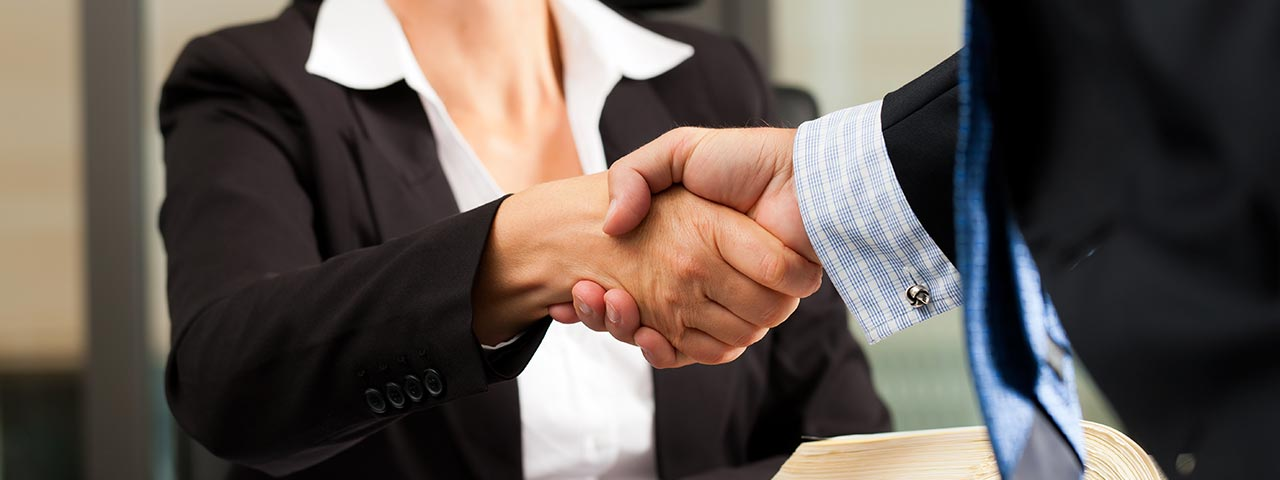 Attorney and client shaking hands
